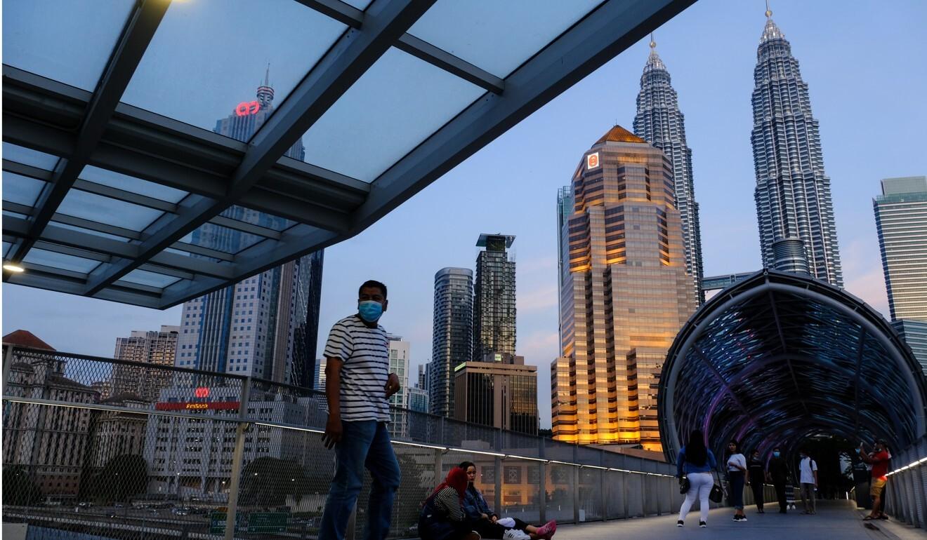 Pedestrians on the Saloma Link bridge in Kuala Lumpur, Malaysia. Photo: Bloomberg