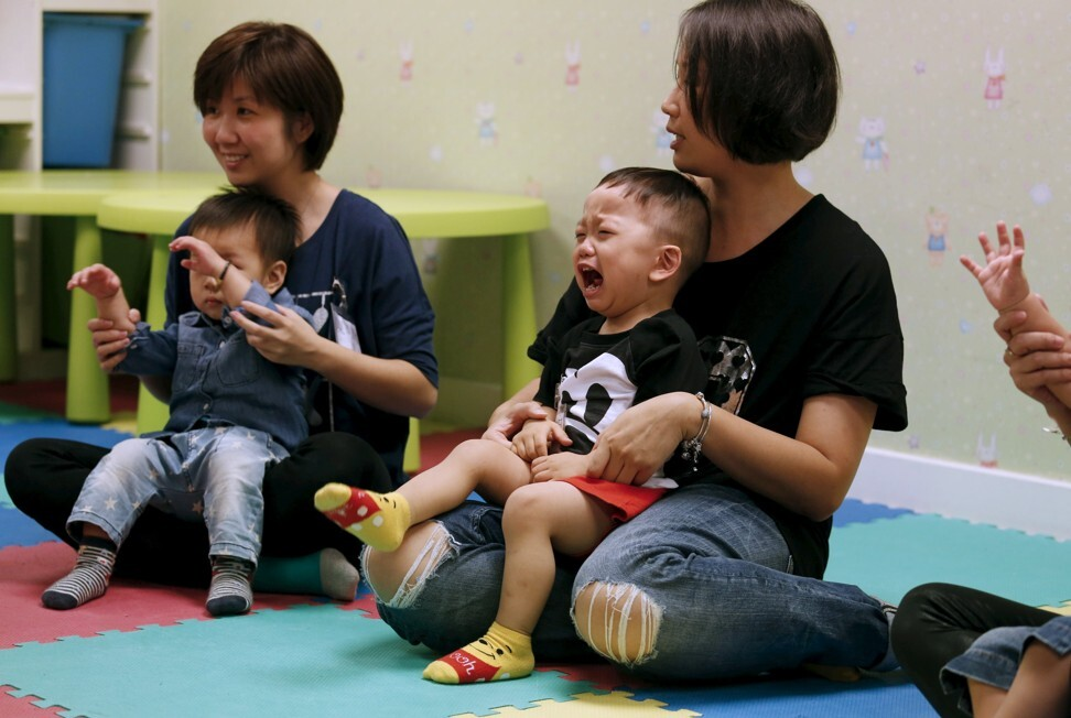 A child cries in the arms of his mother as they take part in a class preparing toddlers for kindergarten interviews in Hong Kong in 2015. Photo: Reuters