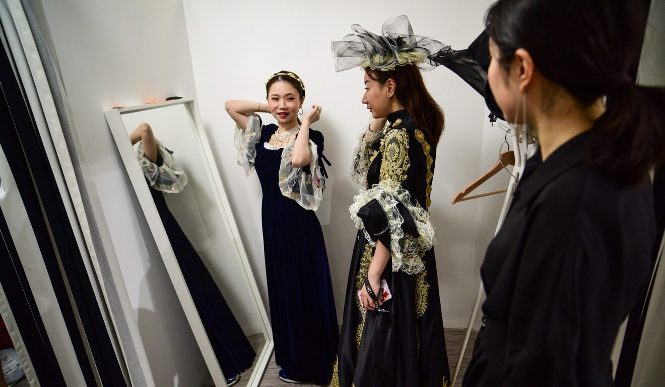 Role-players in a live-action murder mystery game in Shanghai get into character with elaborate costumes. Photo: AFP