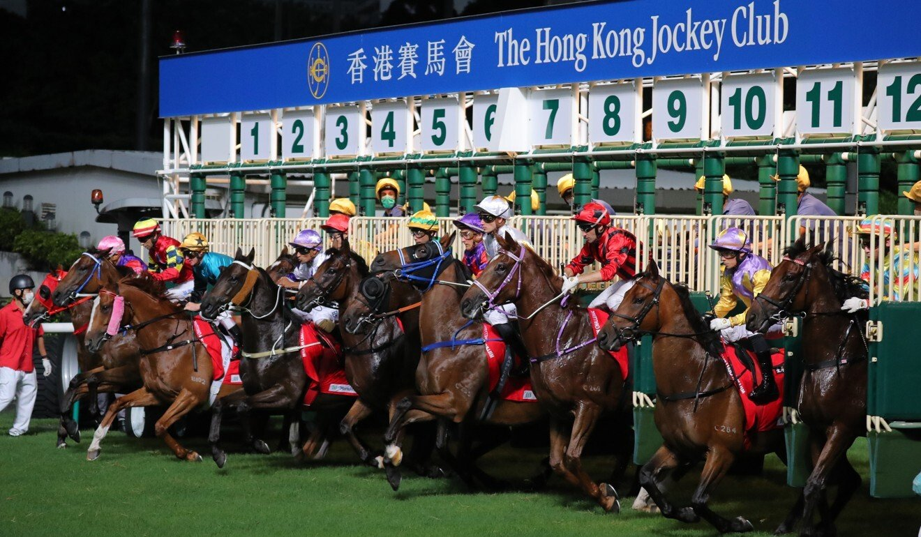 Horses jump from the barriers at Happy Valley.