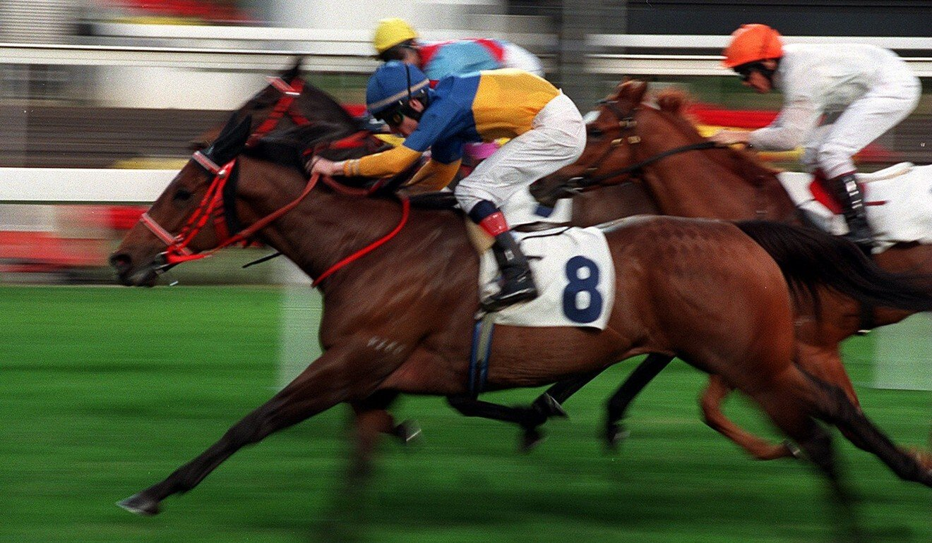 Irish jockey Pat Smullen brings Taurus home at Sha Tin in January 2000.