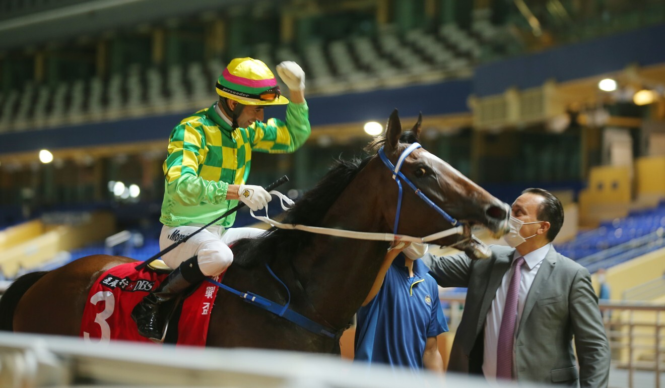 Joao Moreira celebrates with trainer Caspar Fownes during his treble at Happy Valley on Wednesday night.