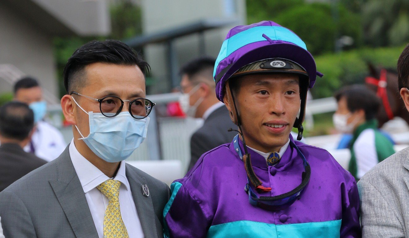 Trainer Frankie Lor and jockey Vincent Ho celebrate Winning Dreamer's most recent victory in July.