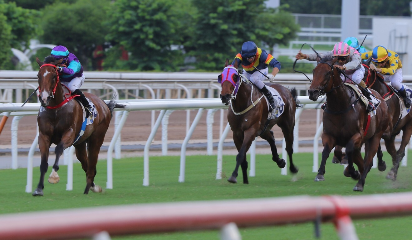 Vincent Ho goes for home on Winning Dreamer at Sha Tin on Sunday.