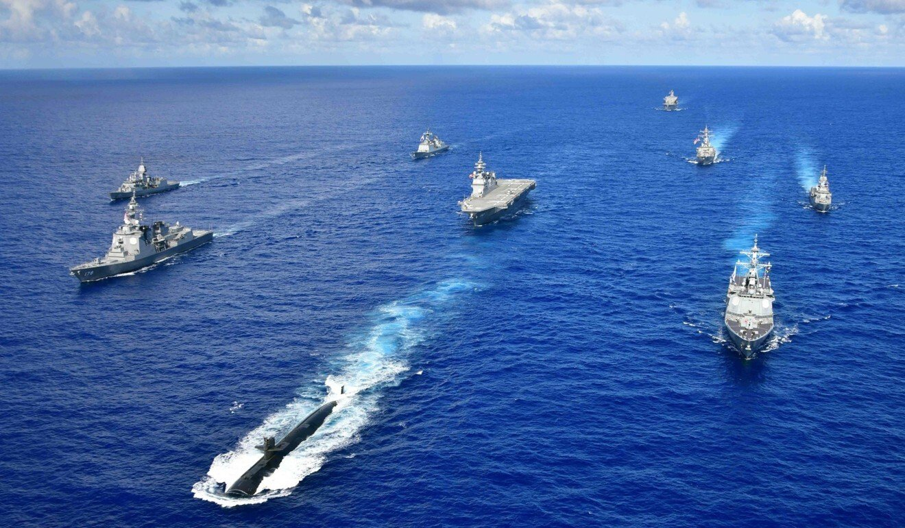 US, Australian and Japanese ships on a joint training exercise. Photo: Handout