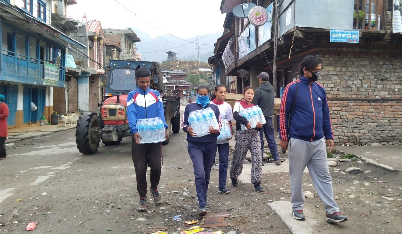 Volunteer athletes deliver water. Photo: Karnali Sports Club