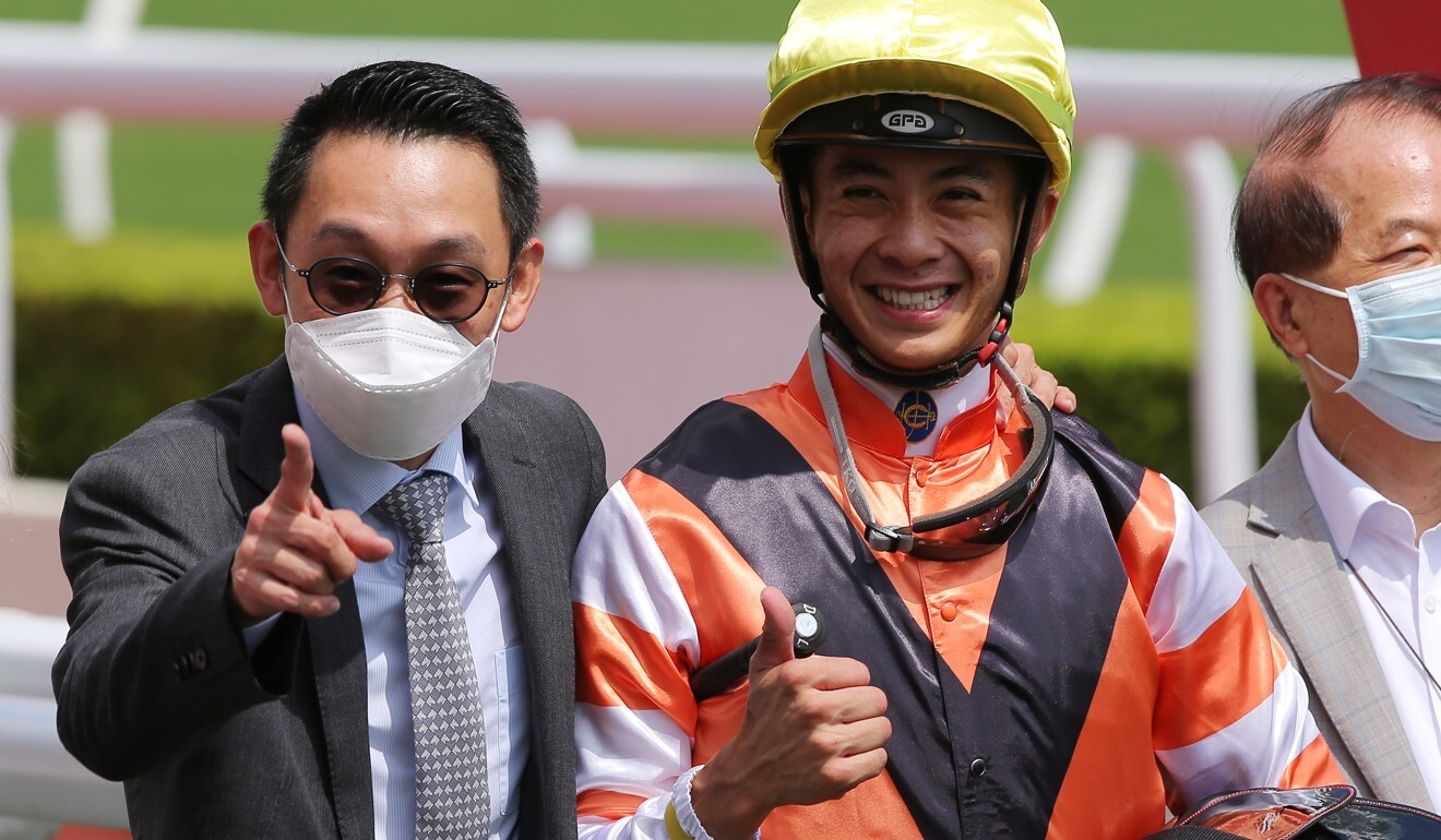 Trainer Jimmy Ting and jockey Derek Leung celebrate Pegasus Glory's win.