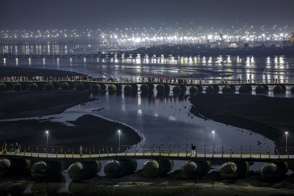 Indian Hindu pilgrims walk on a pontoon bridge before dawn on the banks of Triveni Sangam in Allahabad, now officially known as Prayagraj, during the annual Magh Mela festival in January. Photo: AP