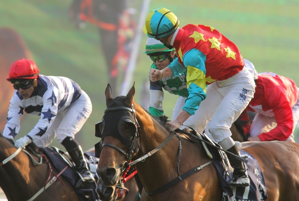 Zac Purton yells back at Douglas Whyte after winning the 2012 Hong Kong Mile on Ambitious Dragon.