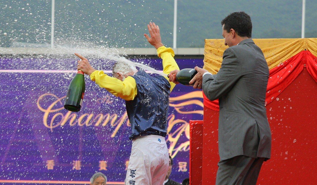 Douglas Whyte sprays Zac Purton with champagne after the Australian won the 2018-19 jockeys' championship.