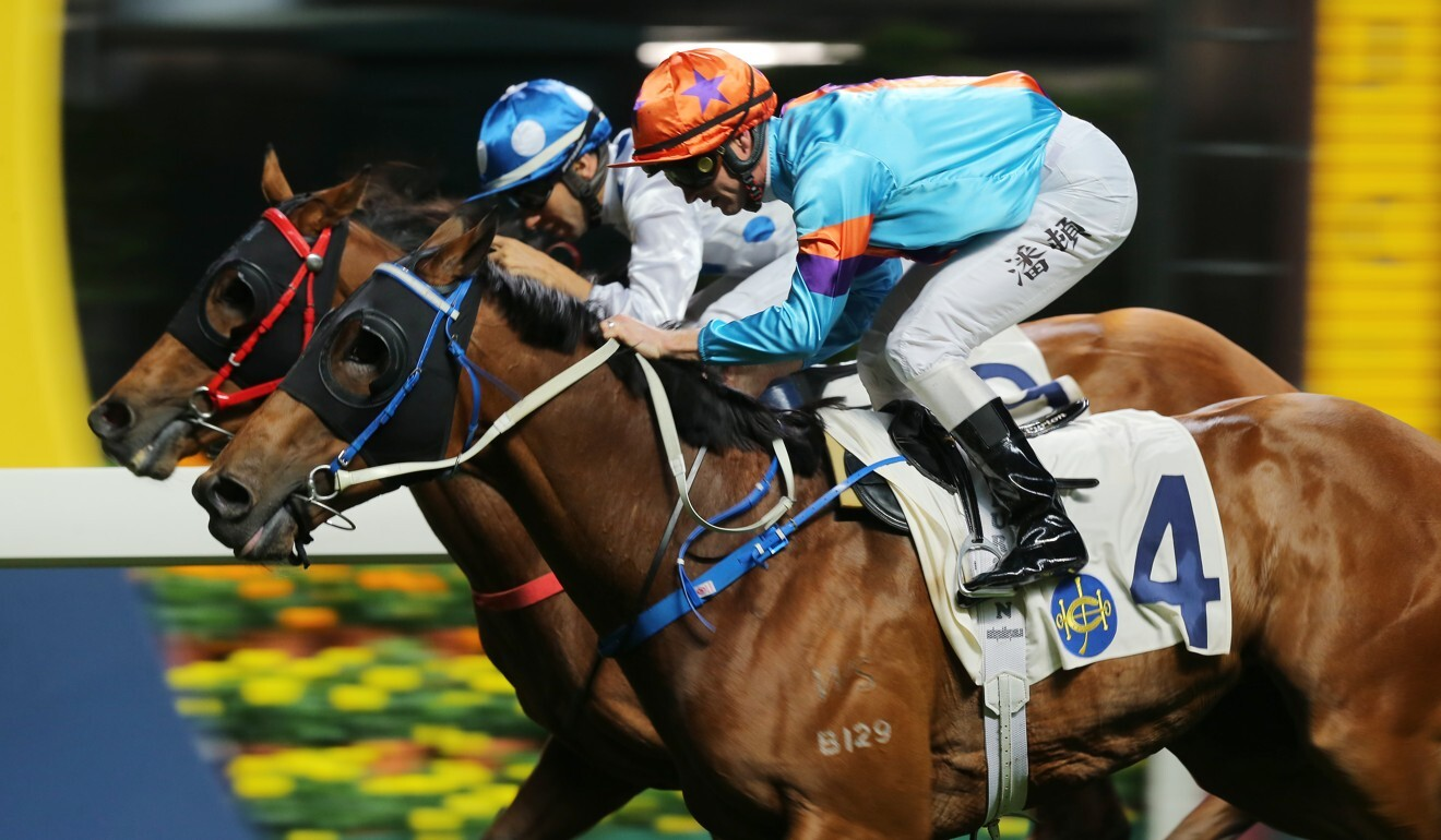 Zac Purton aboard Dances With Dragon (outside) fights out a finish with Joao Moreira and Enrichment last season.