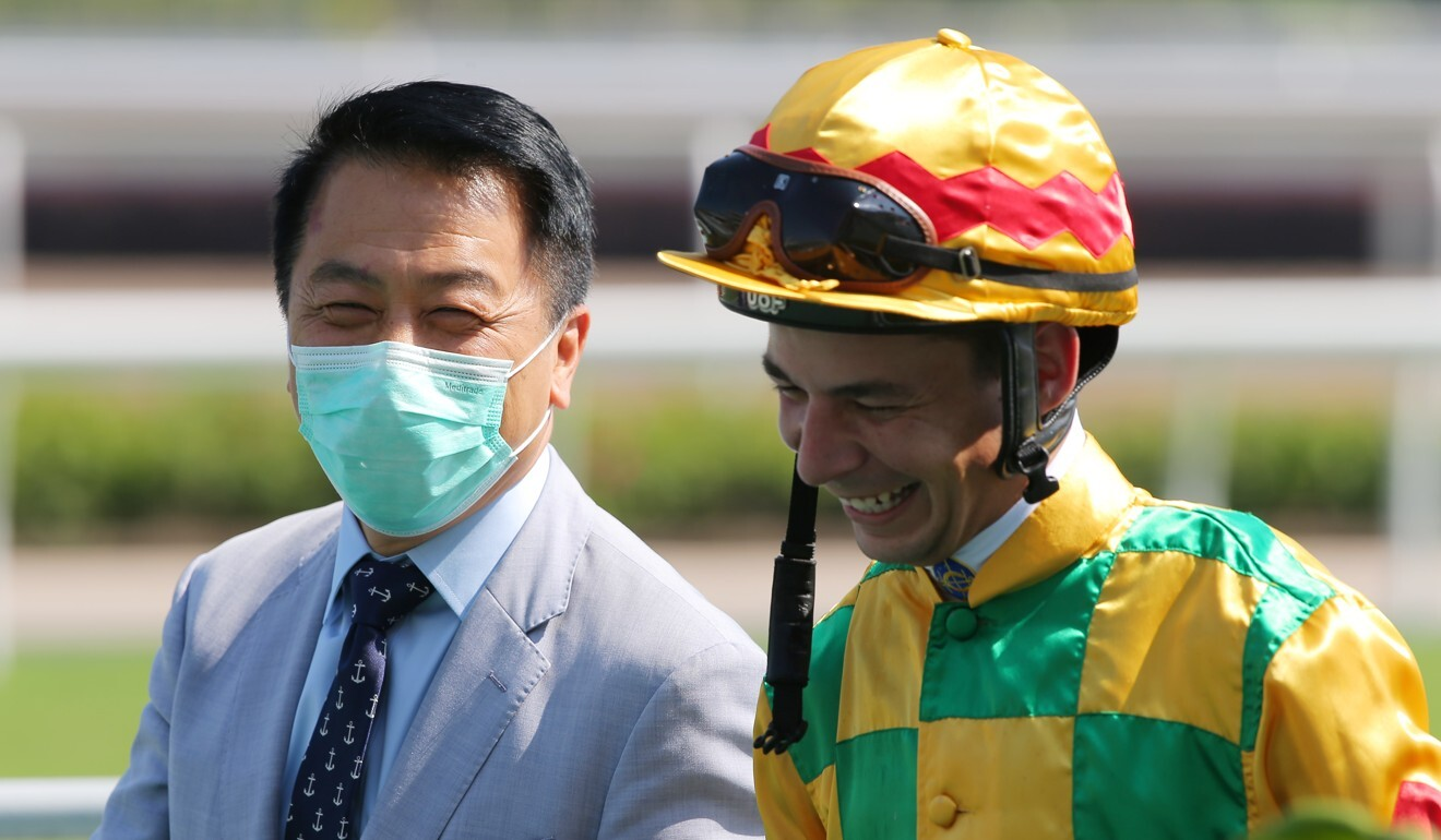 Trainer Ricky Yiu and jockey Vagner Borges are all smiles after Mighty Valor's victory.