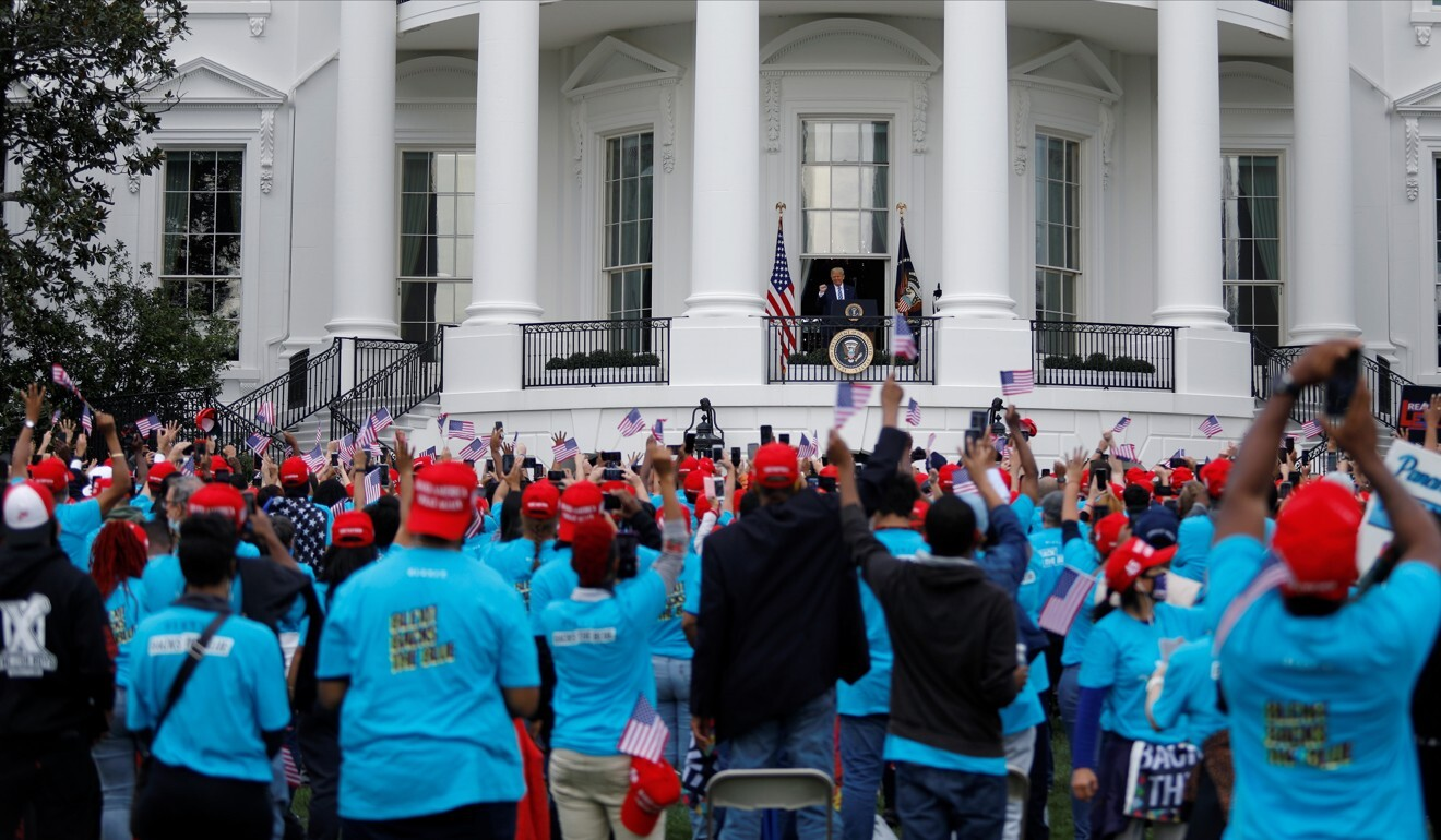 Trump supporters on the South Lawn during the US president's campaign rally on Saturday. Photo: Reuters