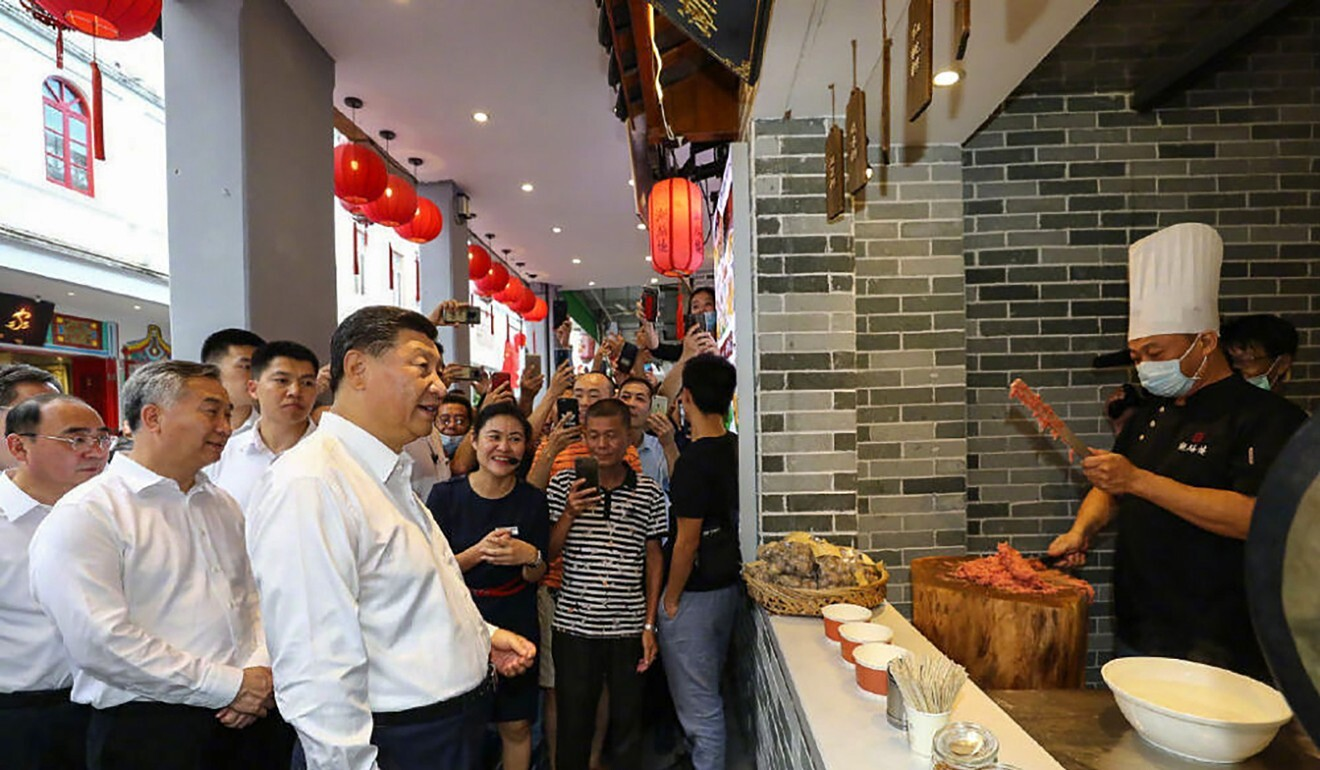 Xi Jinping visits a restaurant at a heritage site in Chaozhou. Photo: Xinhua