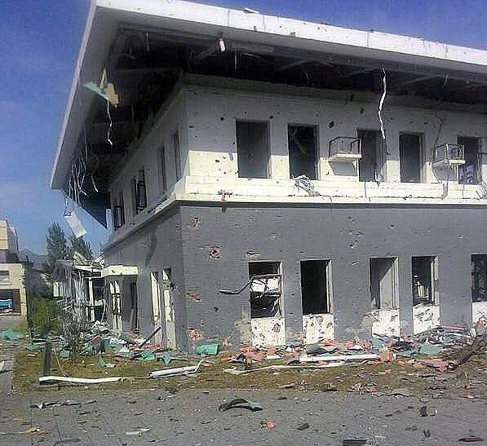The damaged Chinese embassy after a 2016 terrorist attack in Bishkek, Kyrgyzstan. A suspected suicide bomber drove a car through the embassy entrance, setting off a bomb which killed the attacker. Photo: EPA