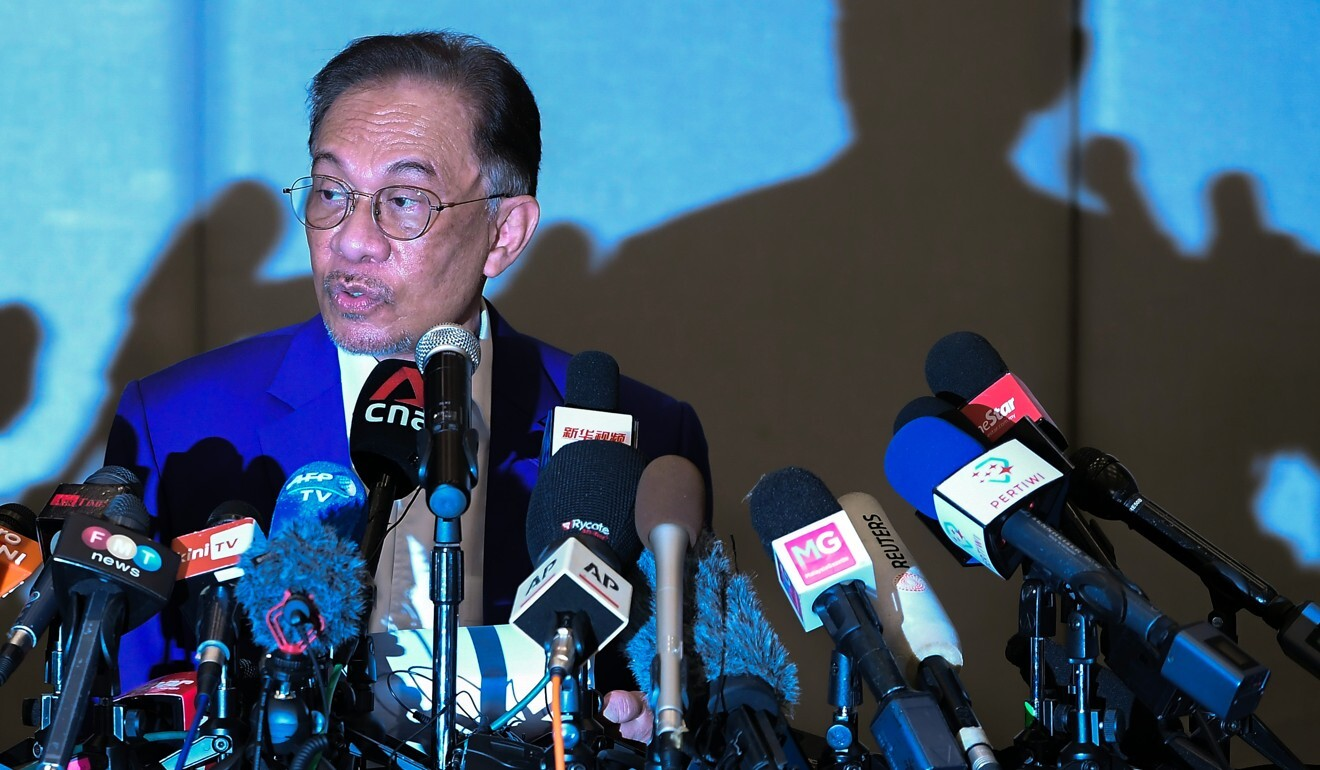 Malaysian opposition leader Anwar Ibrahim speaks during a press conference after his meeting with the king. Photo: Bernama / DPA
