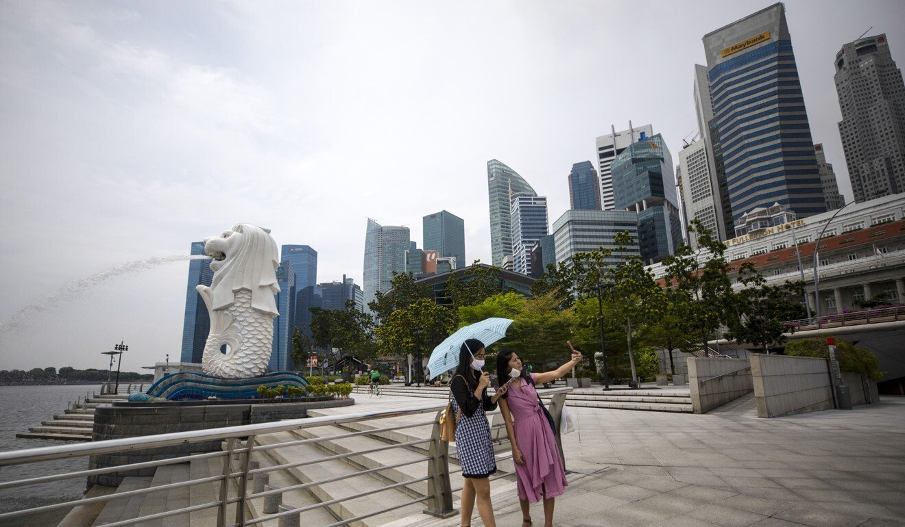 Singapore and Hong Kong have reached a preliminary agreement to establish the world's first two-way, quarantine-free travel bubble. Photo: EPA-EFE