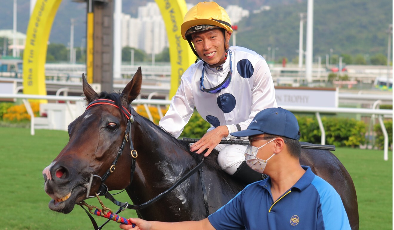 Vincent Ho is all smiles as he heads to the winner's circle aboard Golden Sixty.