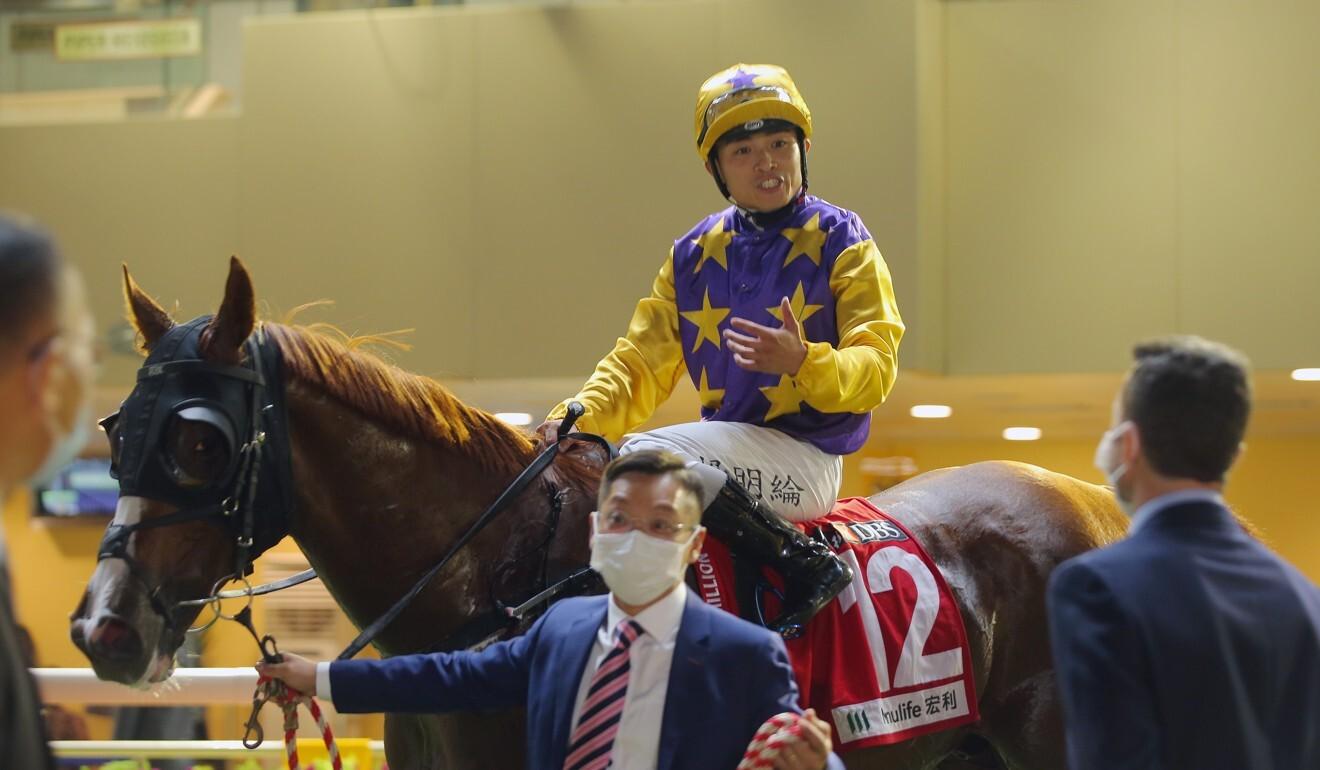 Jockey Keith Yeung aboard Amazing Kiwi after their win.