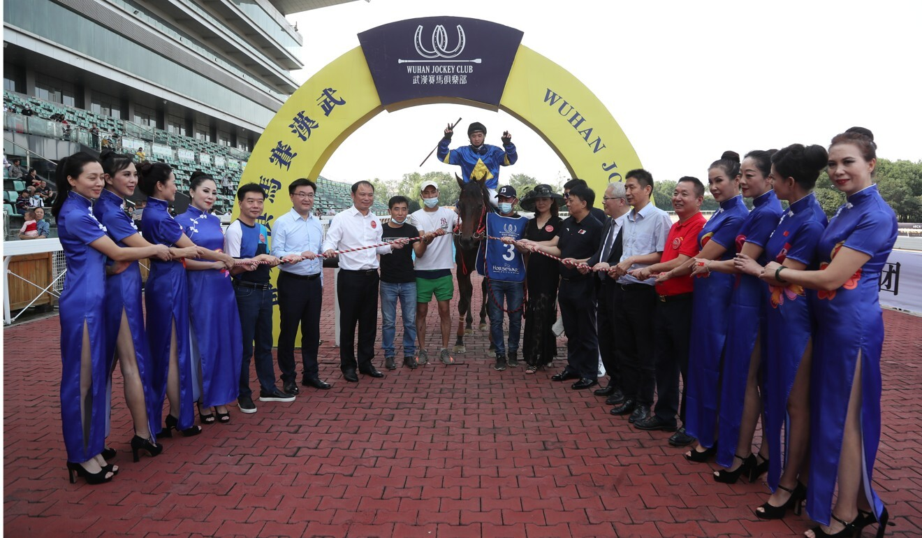 Connections celebrate a winner during the Wuhan Jockey Club's National Day meeting. Photo: Wuhan Jockey Club
