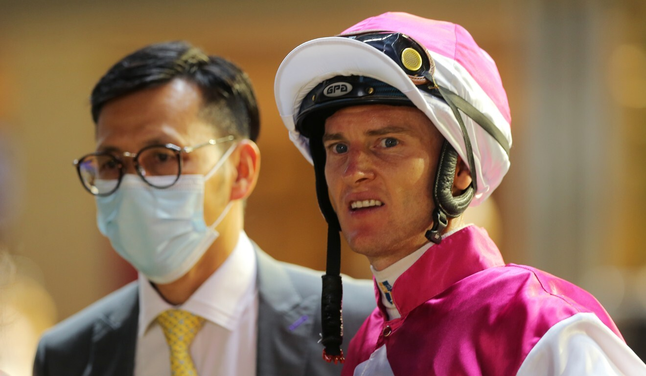 Frankie Lor with Zac Purton after a Happy Valley winner.