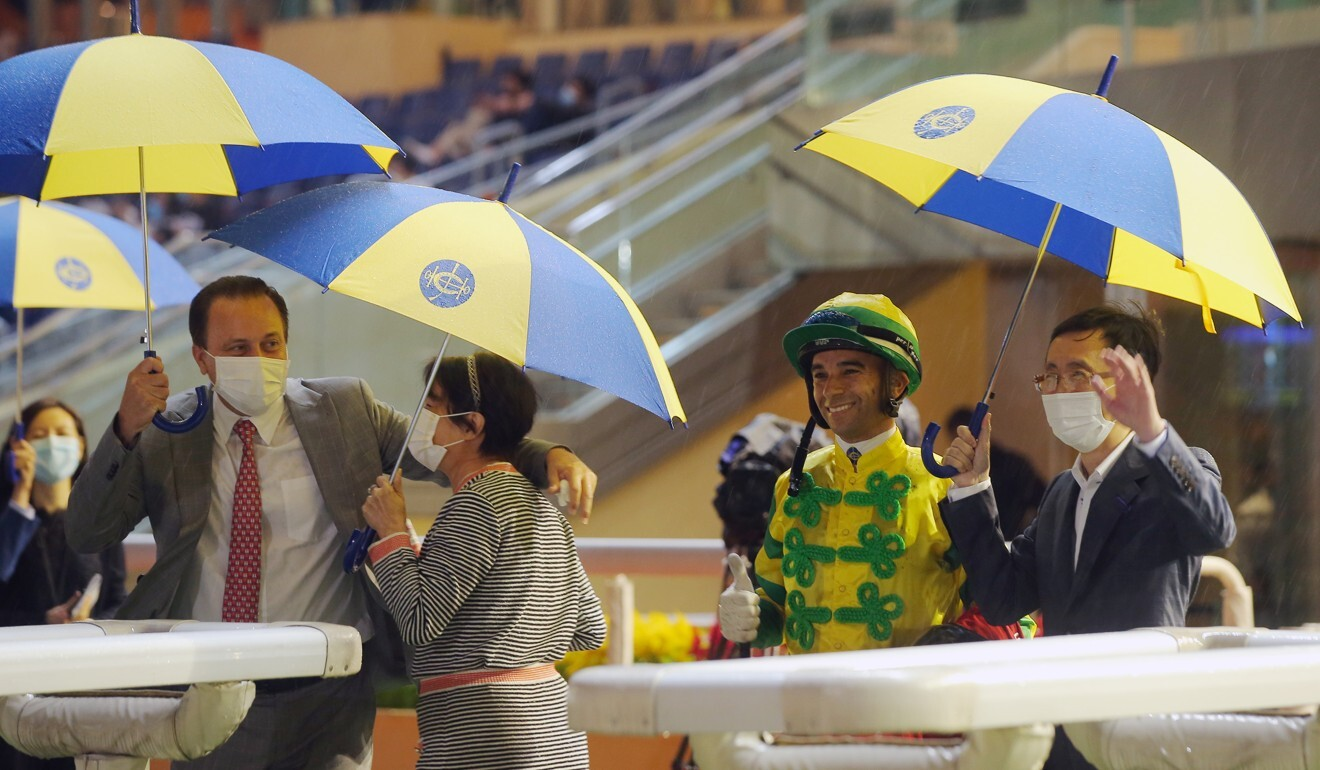 Caspar Fownes and Joao Moreira with the connections of Sky Darci after his win on Wednesday night.