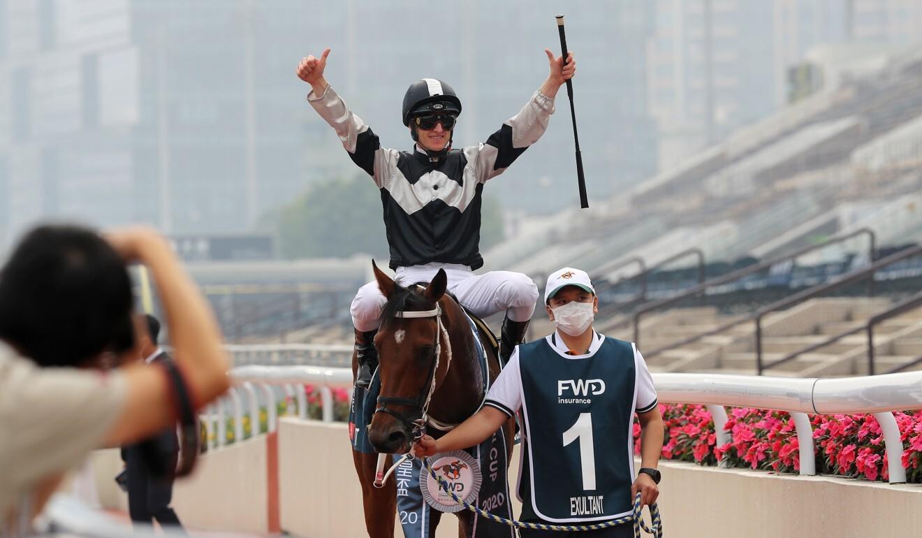 Zac Purton celebrates his win aboard Exultant.