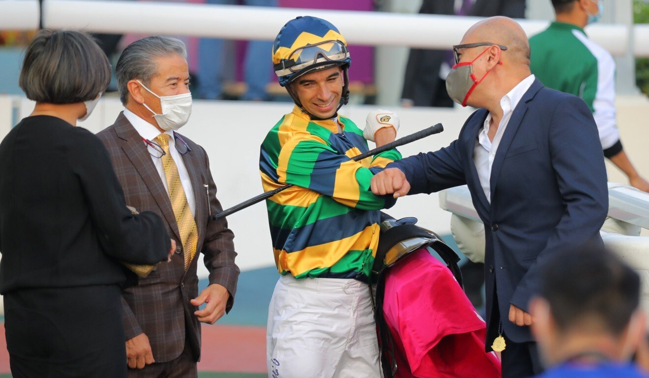 Trainer Tony Cruz and jockey Joao Moreira with connections of Furore after their Ladies' Purse victory.