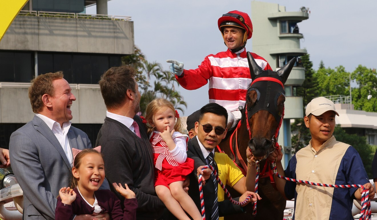 Melvyn Ford (second from left) with connections of Wayfoong Vinnie after a win at Sha Tin.