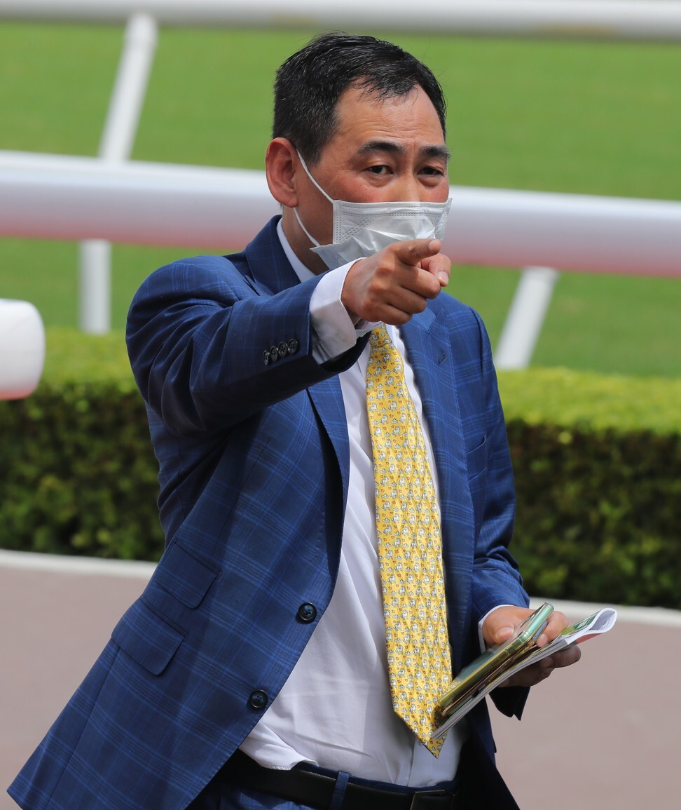 Trainer Michael Chang celebrates a winner.