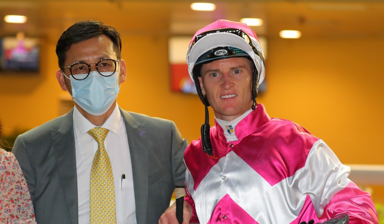 Zac Purton with trainer Frankie Lor following a Happy Valley winner.
