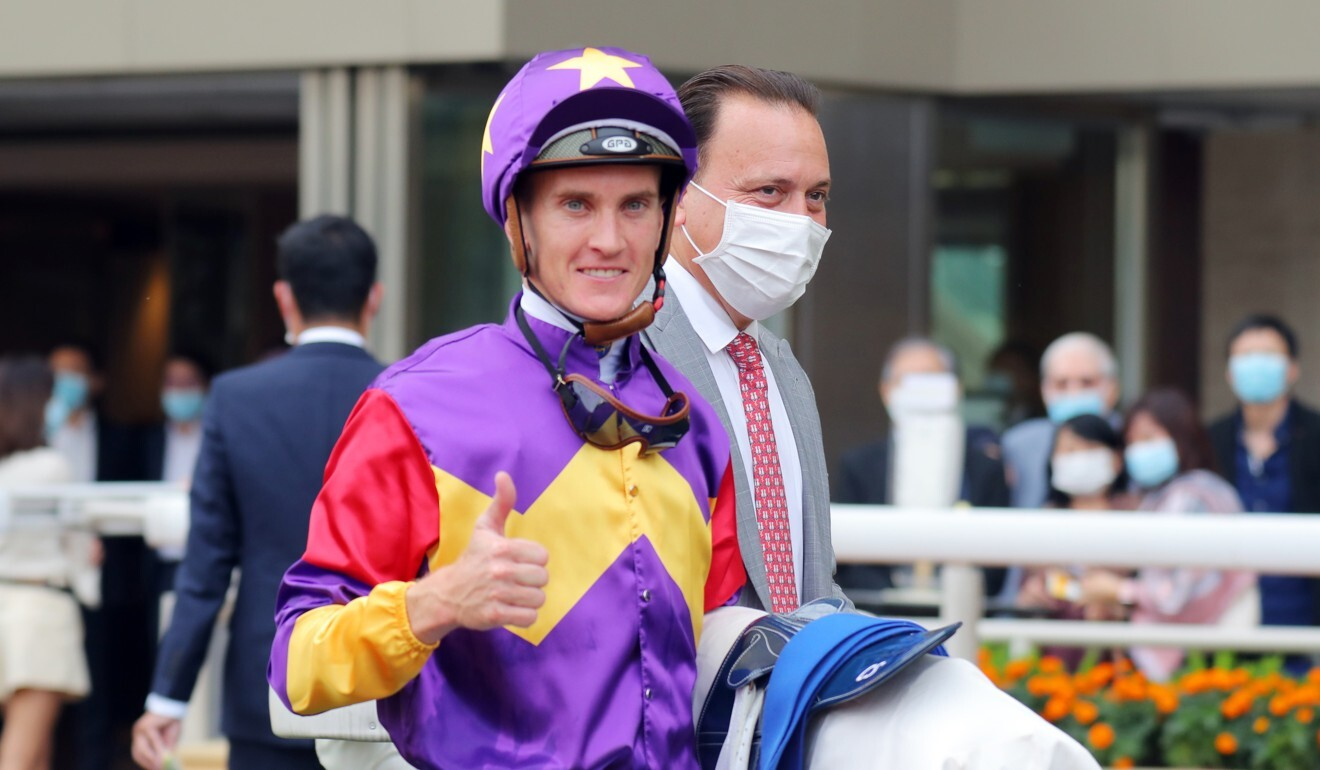 Jockey Chad Schofield with Caspar Fownes after Lucky Quality's win at Happy Valley.