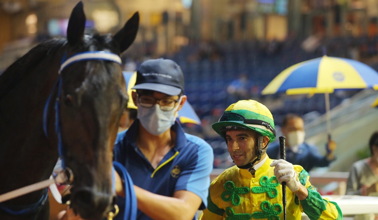 Joao Moreira with Sky Darci after winning at Happy Valley.