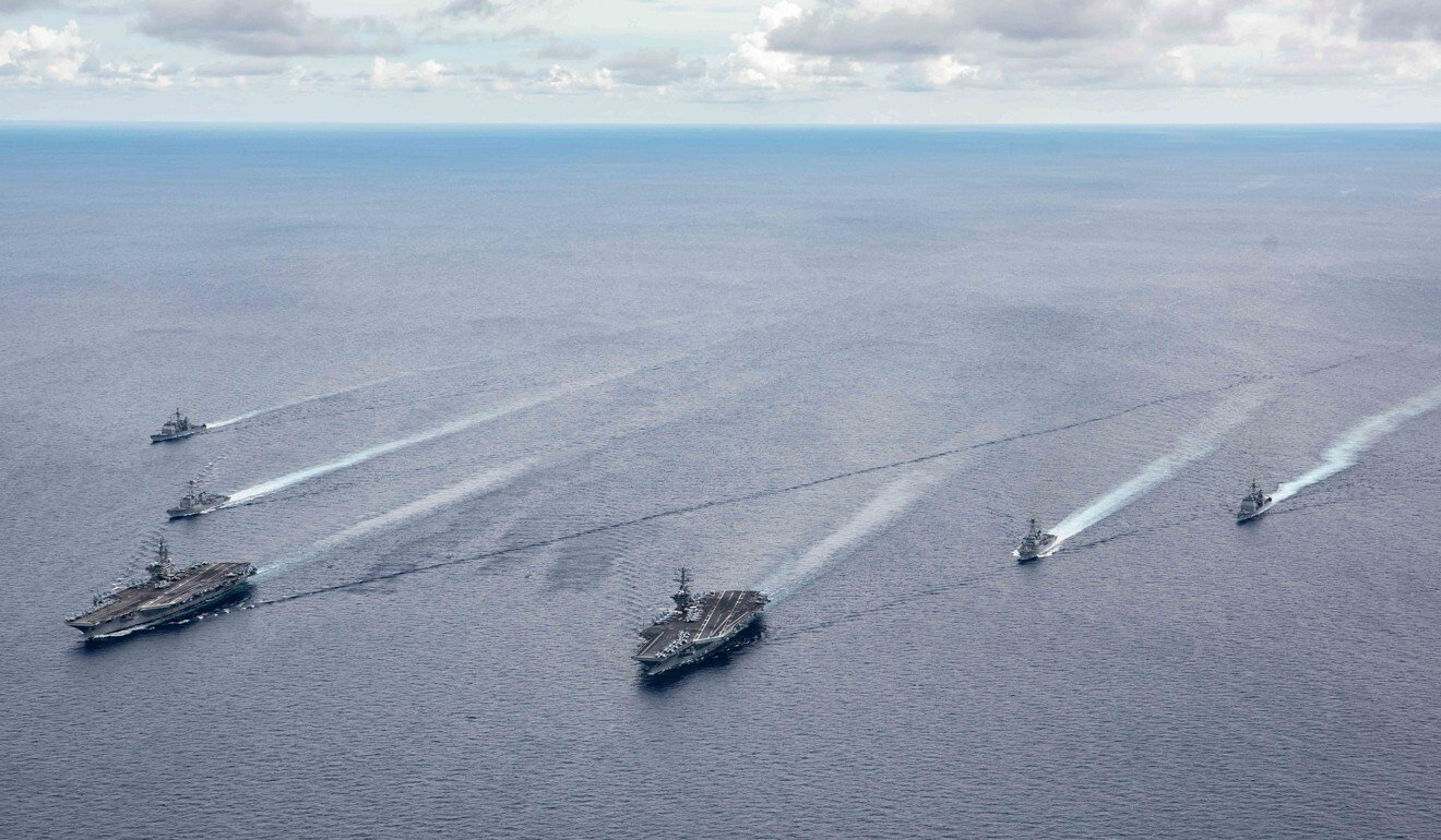 US aircraft carriers and their strike groups take part in a drill in the South China Sea in July. Photo: EPA-EFE