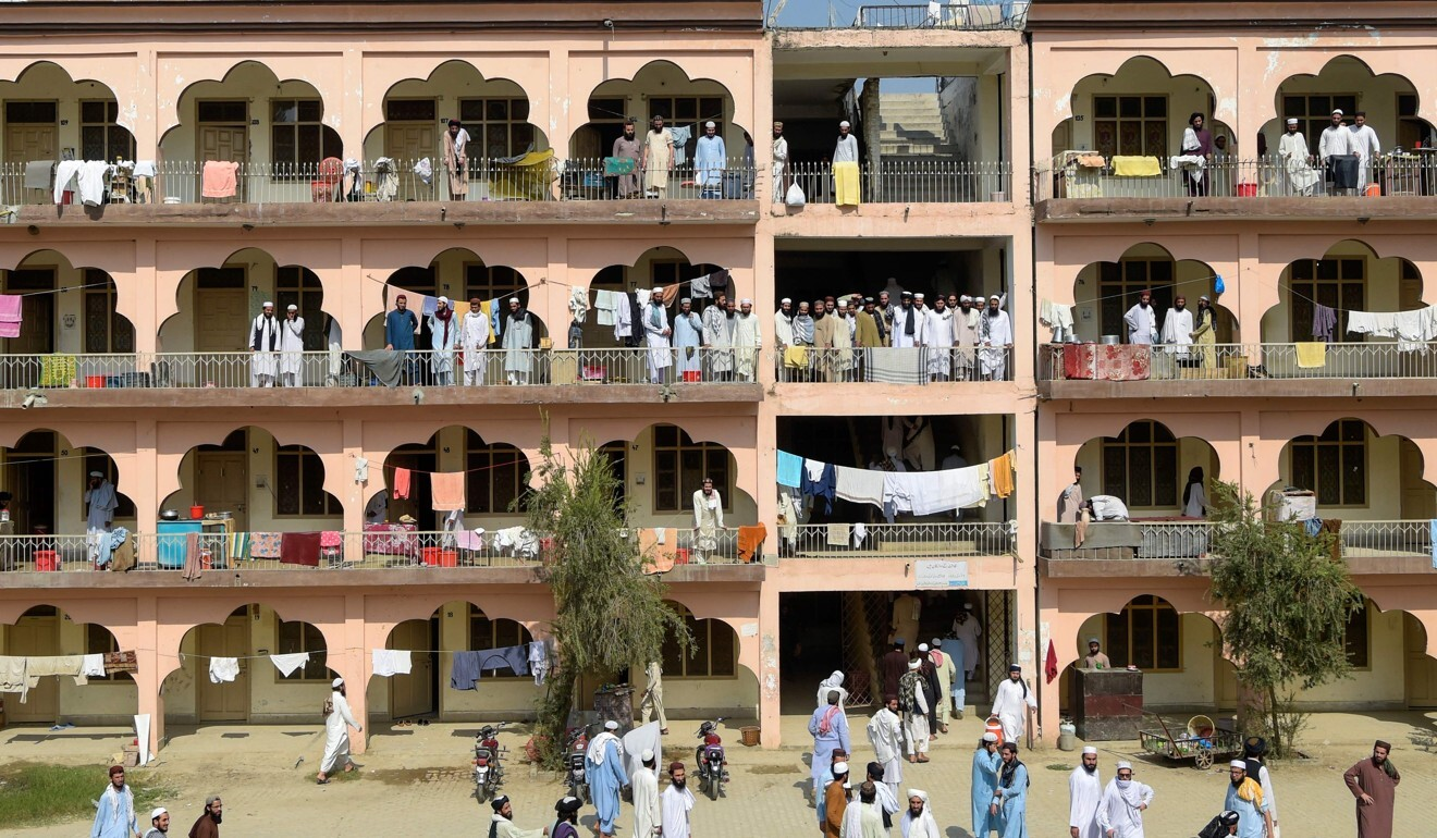 Islamic seminary students gather in the premises of the hostel at the Darul Uloom Haqqania seminary. Photo: AFP