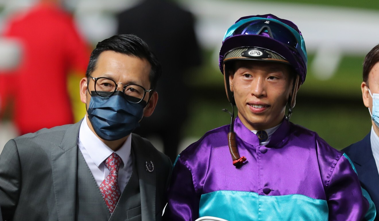 Trainer Frankie Lor and jockey Vincent Ho after Winning Dreamer's victory.