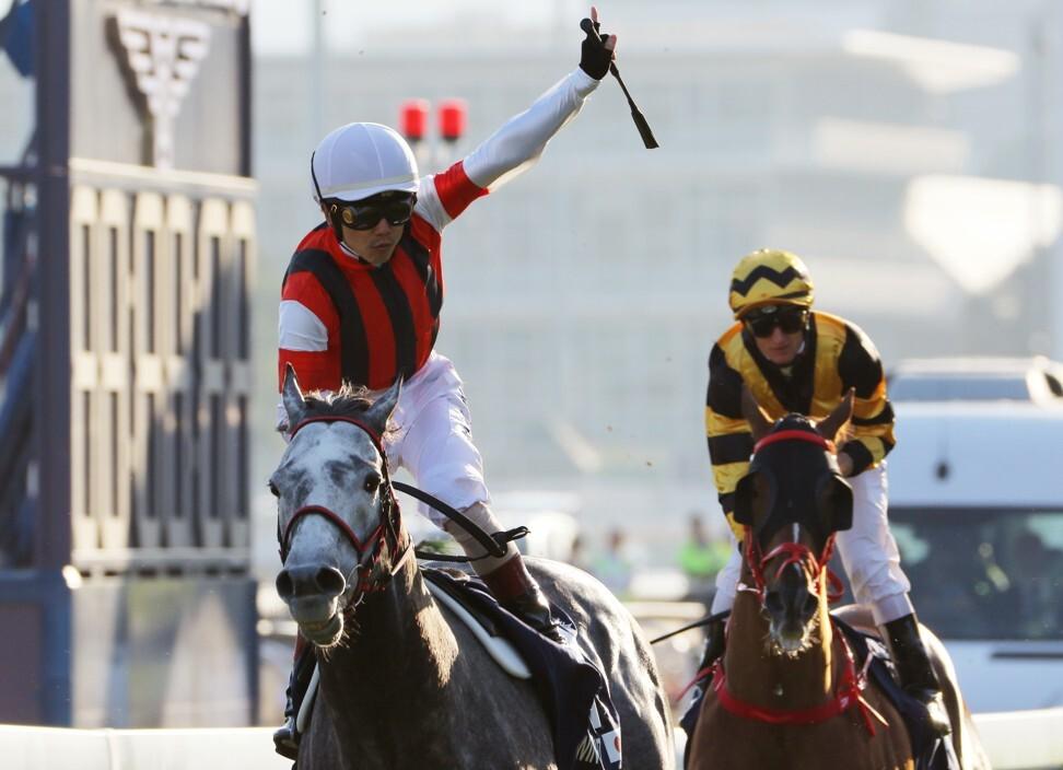 Jockey Masami Matsuoka salutes as Win Bright takes out the 2019 Hong Kong Cup.