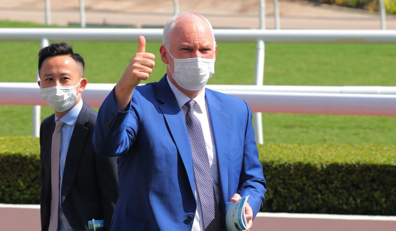 Trainer David Hall celebrates a winner.