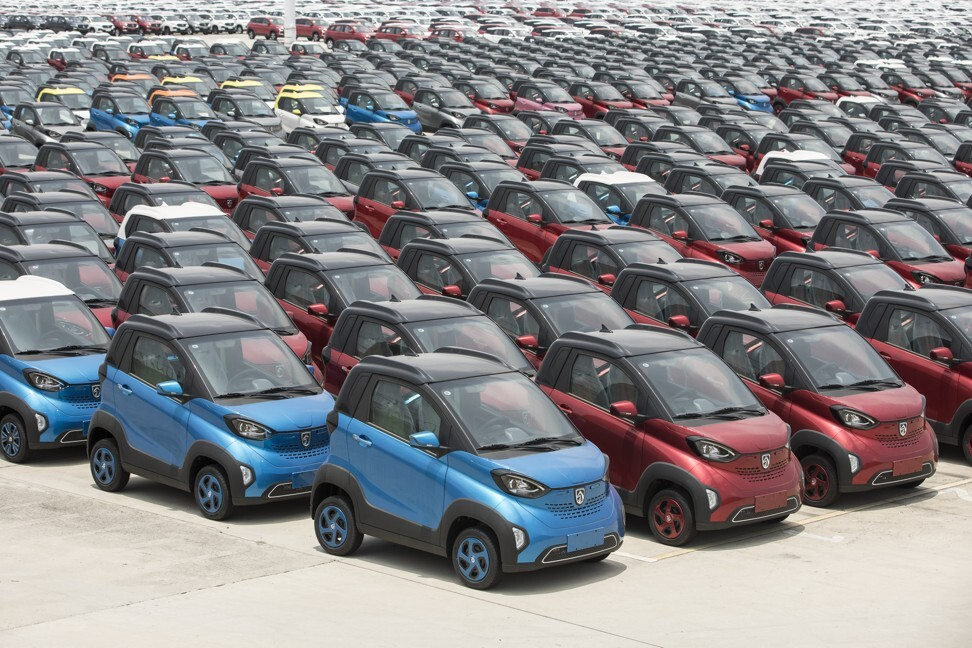 Hundreds of Baojun E100 electric vehicles in the parking lot of the SAIC-GM-Wuling Automobile plan in Liuzhou city of Guangxi province on May 23, 2018. Photo: Bloomberg