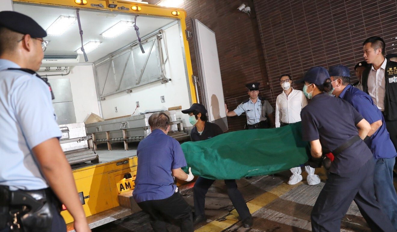 The body of Cheung's wife being removed from campus in 2018. Photo: K. Y. Cheng