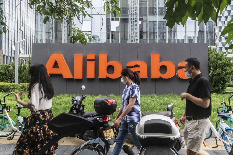 Pedestrians outside Alibaba Group Holding's building in Beijing on August 19, 2020. Photo: Bloomberg