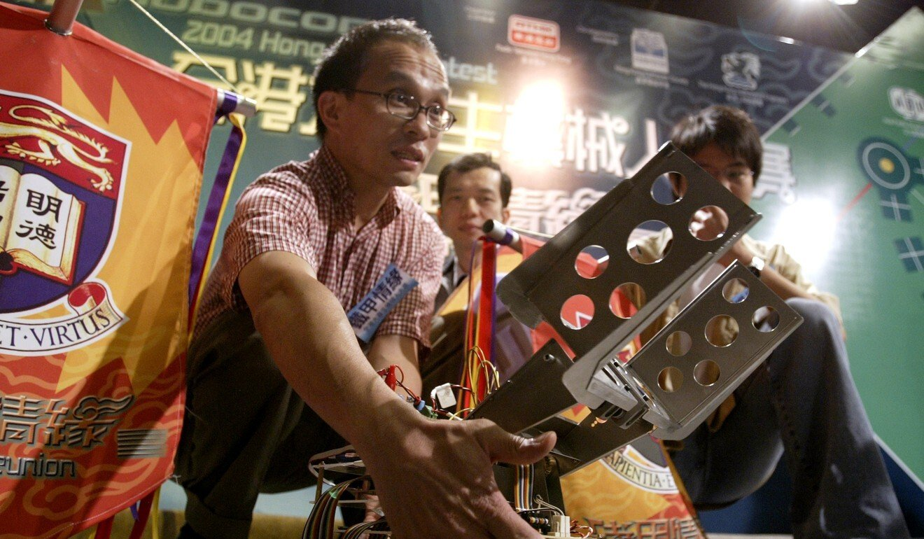 A younger Cheung inspects a robot designed by students in 2004. Photo: Dickson Lee