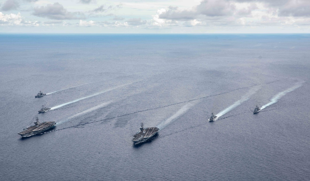 Aircraft carriers USS Ronald Reagan and USS Nimitz and their carrier strike groups in formation during a drill in the South China Sea in July. Photo: US Navy Office of Information via EPA-EFE