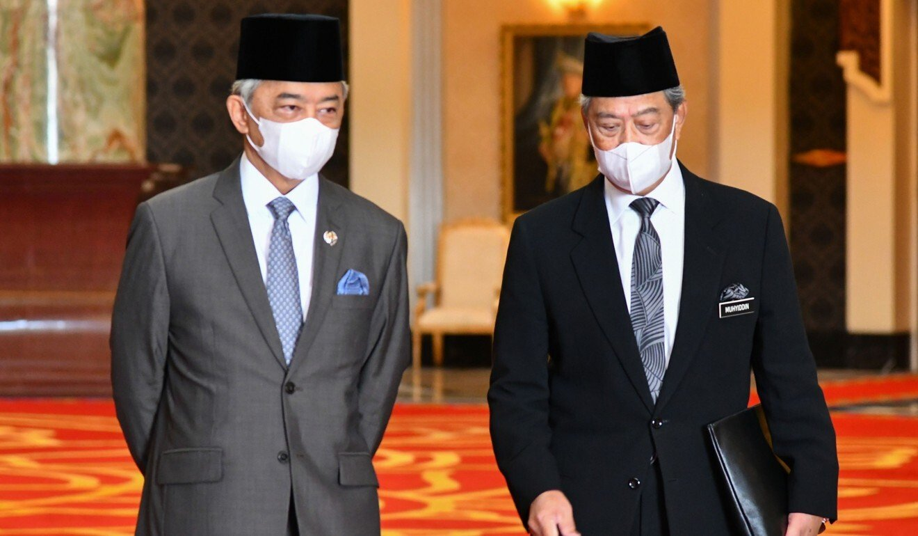 Malaysia's Prime Minister Muhyiddin Yassin (right) talking with King Sultan Abdullah during a meeting at the National Palace in Kuala Lumpur. Photo: AFP