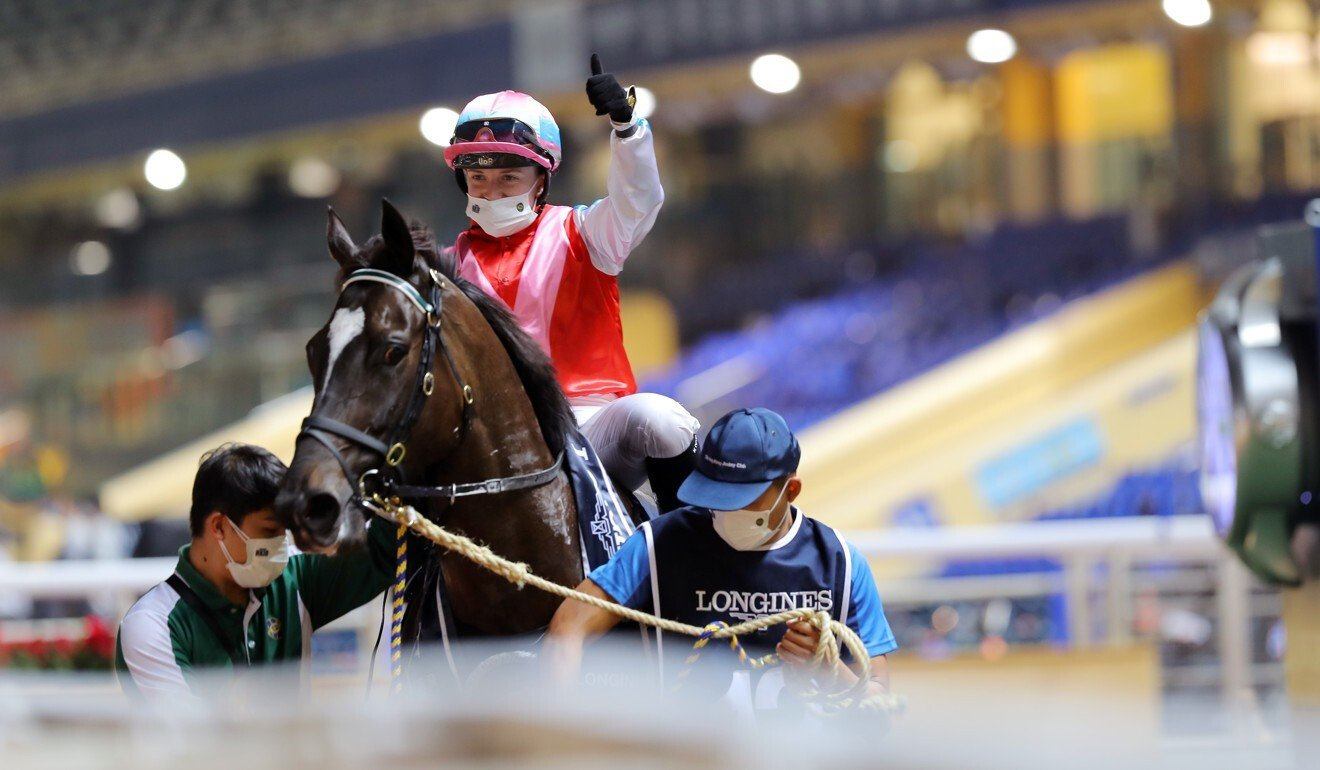 Hollie Doyle celebrates her victory aboard Harmony N Blessed at Happy Valley.