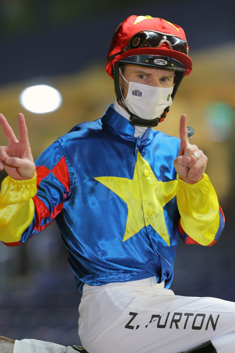 Zac Purton celebrates his 1,200th Hong Kong win on Wednesday night.