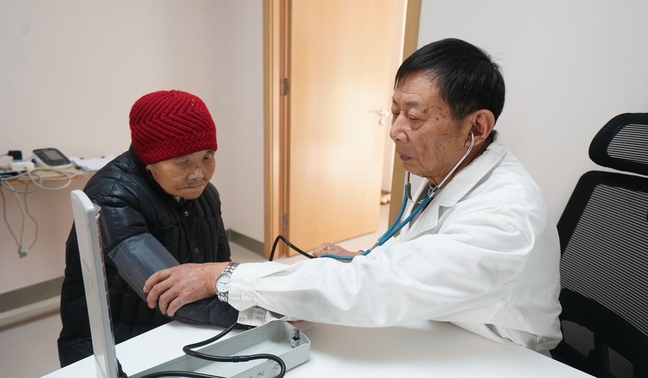 A health worker checks a woman's blood pressure at a care centre in Jiangsu province. Getting an appointment to see a specialist at a public hospital has long been an ordeal in China. Photo: Xinhua
