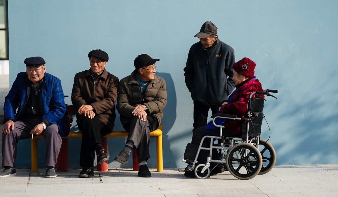 Elderly residents chat outside a community care centre in Suzhou, Jiangsu province, earlier this month. Photo: Xinhua