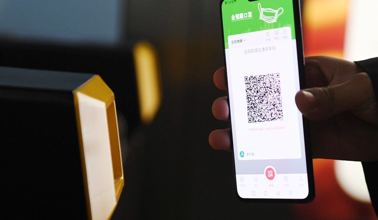 A passenger uses a QR code to pay their subway fare in Beijing earlier this month. Photo: Xinhua