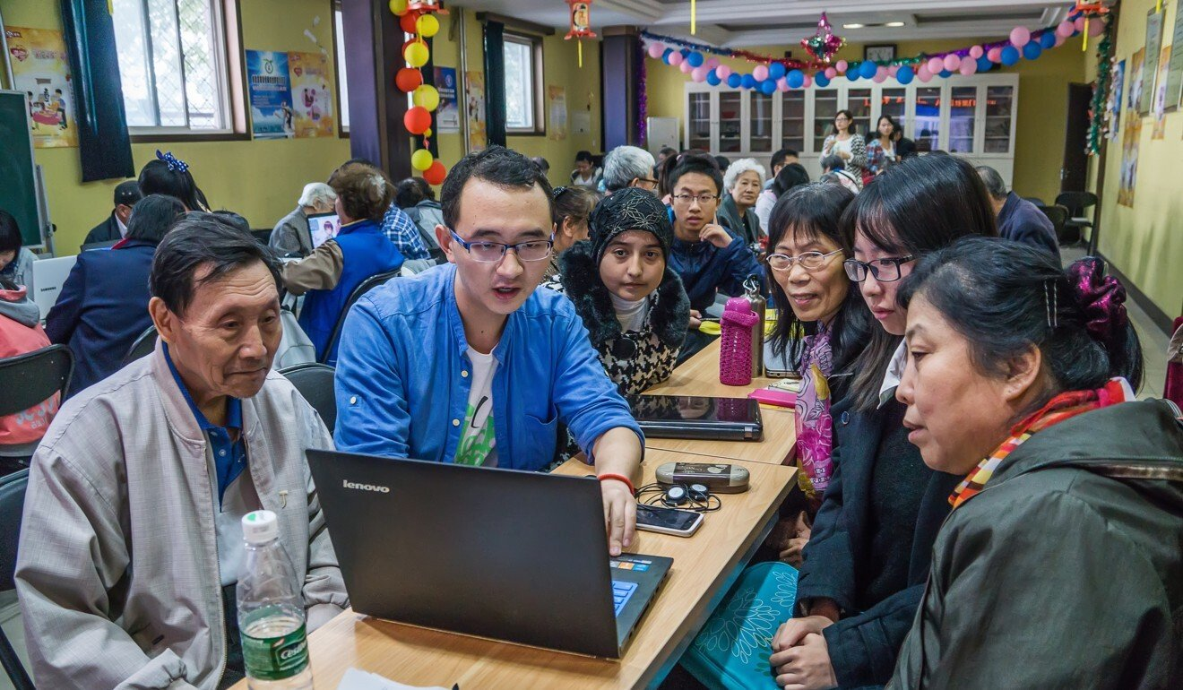 Elderly Beijingers learn how to use digital devices at a session provided by See Young, a charity which has been helping old people navigate the digital world since 2011. Photo: courtesy of See Young